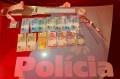 Policiais apreenderam apetrechos característicos da prática criminosa e dinheiro - Divulgação / PM