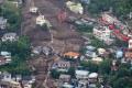 Quase 130 casas e outros edifícios foram destruídos, ou danificados, no deslizamento de terra  - Japan Weather Landslide/ AFP